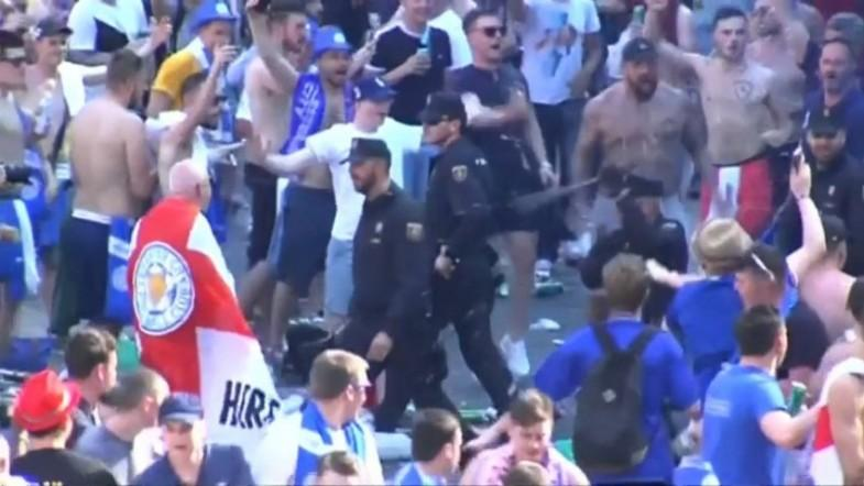 Shocking footage of heavy handed riot police and Leicester City fans in Madrid