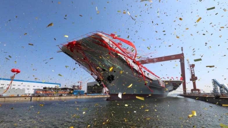 China unveils first home-built aircraft carrier