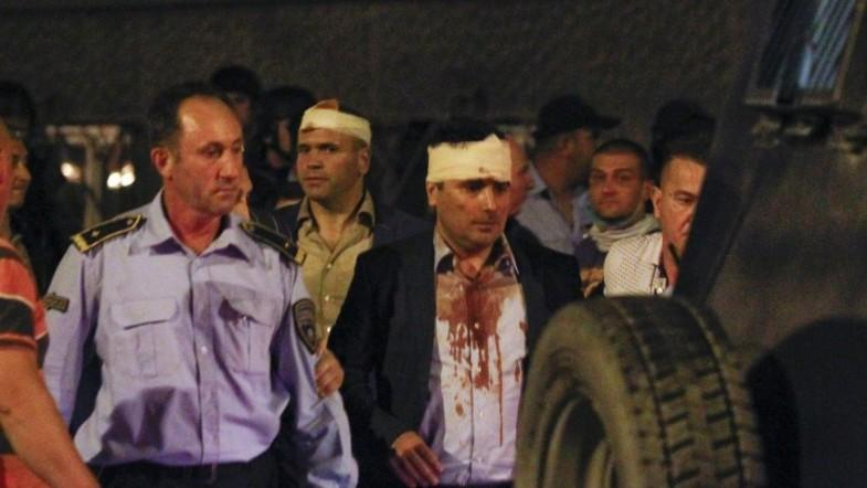 Macedonian MPs attacked as 200 protesters storm parliament