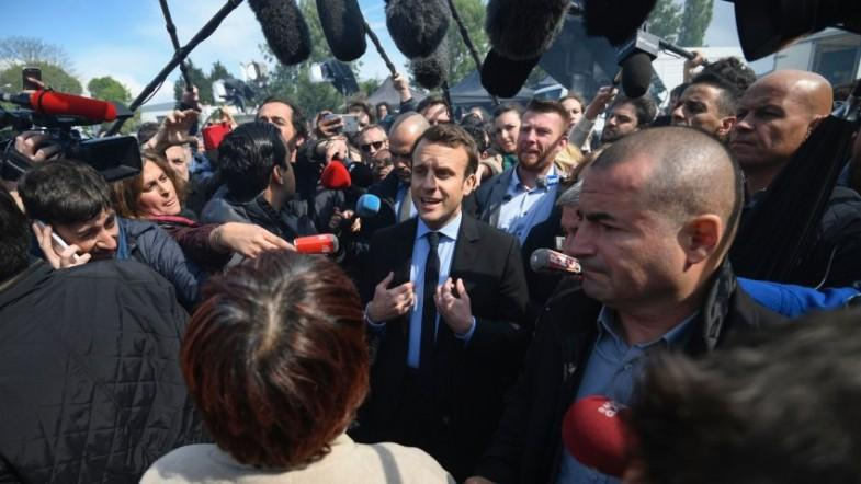 Emmanuel Macron booed by crowd and upstaged by Marine Le Pen over Whirlpool factory closure
