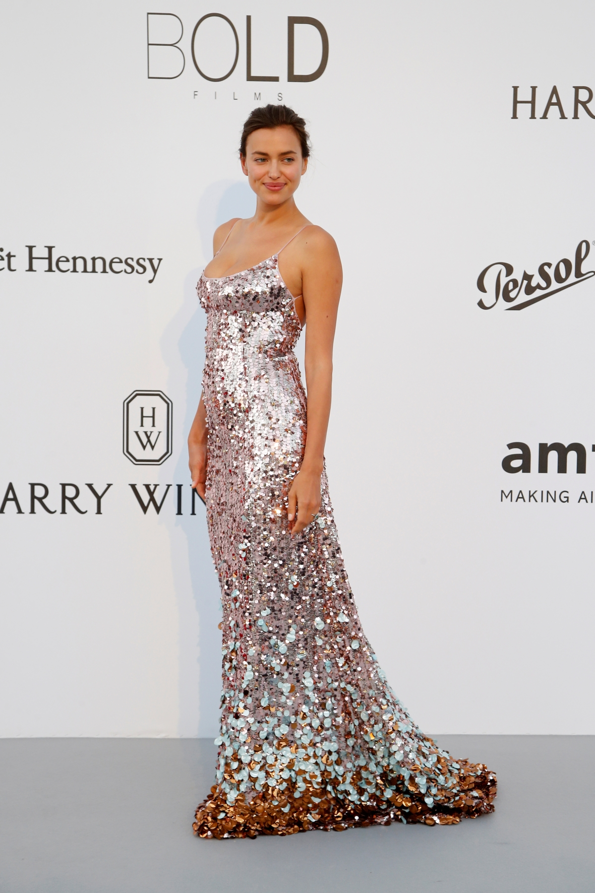 Irina Shayk puts on a busty show in a dazzling metallic gown [PHOTOS ...