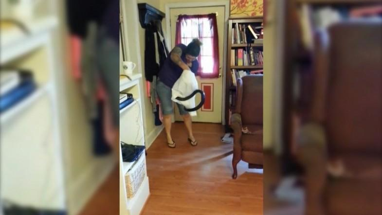 Terrifying moment woman catches six-foot snake with pillow case