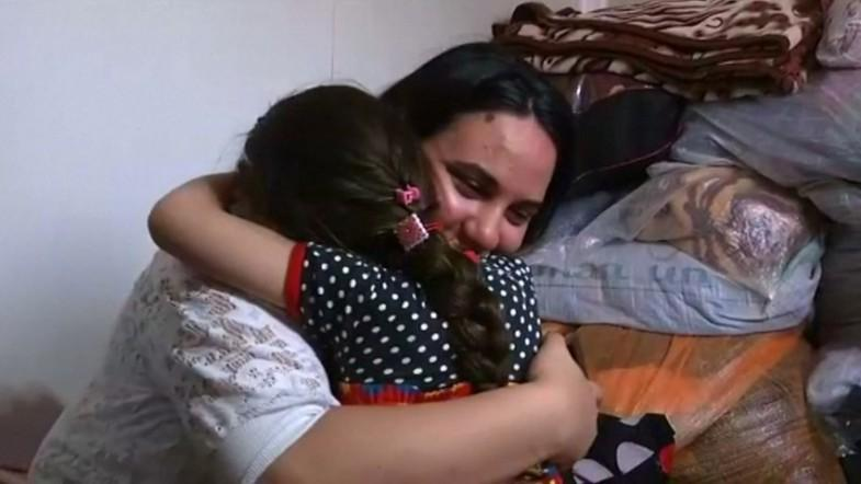 Iraqi girl is reunited with her family three years after Isis kidnapping