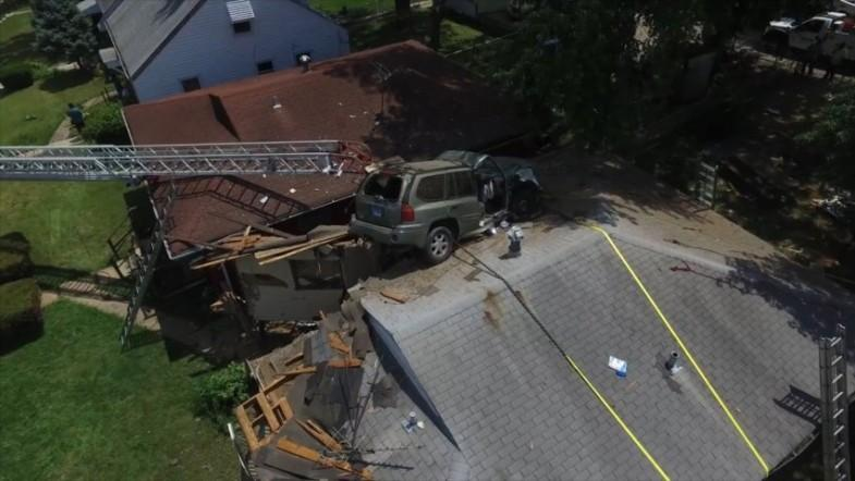 Out of control car goes airborne and crashes into roof of Missouri home