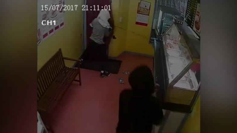 Bumbling thief attempts to take cash register still plugged into wall