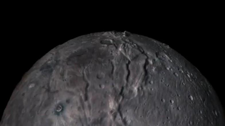 Nasa has created flyby videos of Pluto and Charon, its largest moon