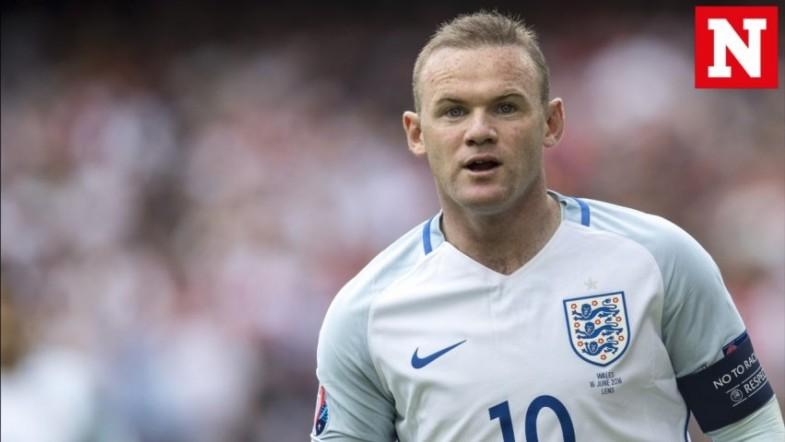 England captain Wayne Rooney retires from international duty