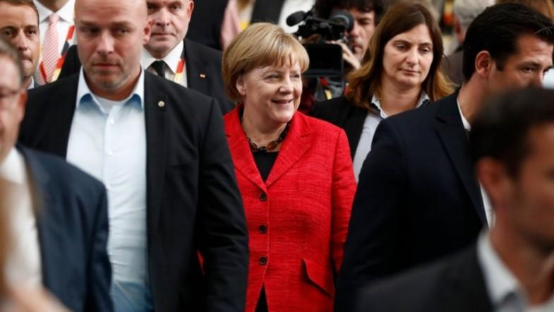 Germany starts voting as history beckons for Merkel