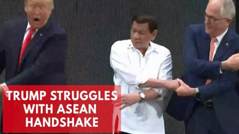 Donald Trump struggles with ASEAN group handshake
