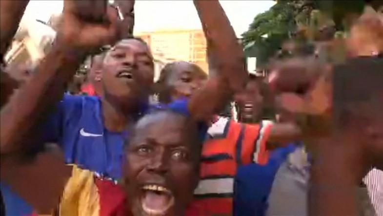 Zimbabweans celebrate after President Robert Mugabe resigns