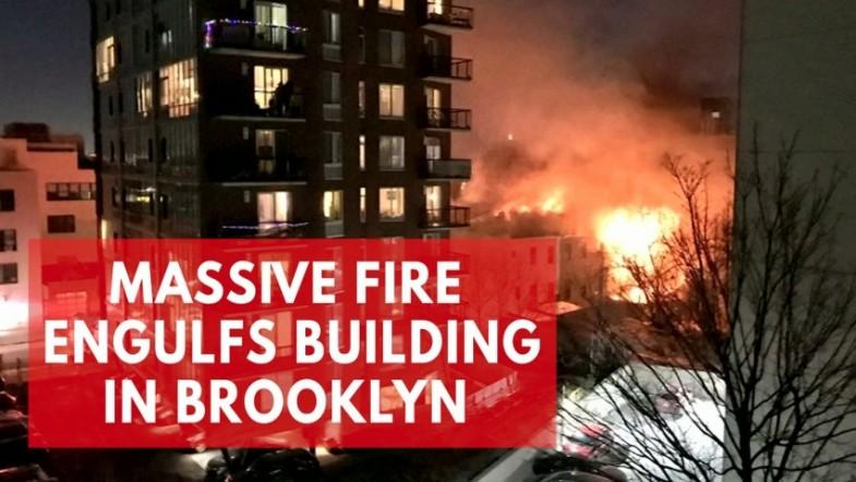 Massive fire engulfs residential building in New York