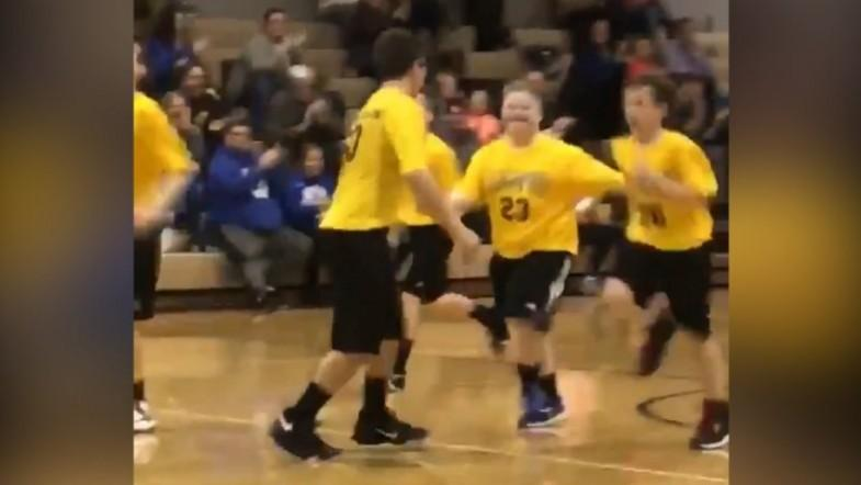 Watch heartwarming video as team cheers boy with Down Syndrome scoring in basketball game