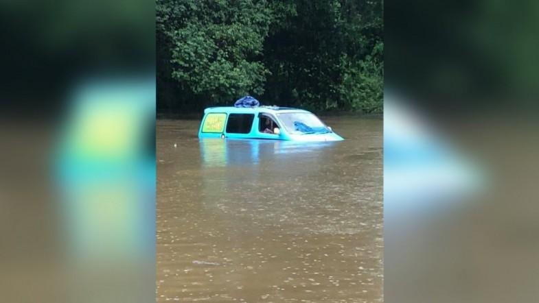 British backpackers wake up to find van partially submerged by floodwaters