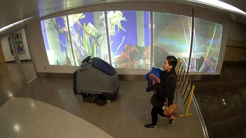 Police search for woman who abandoned newborn baby at airport