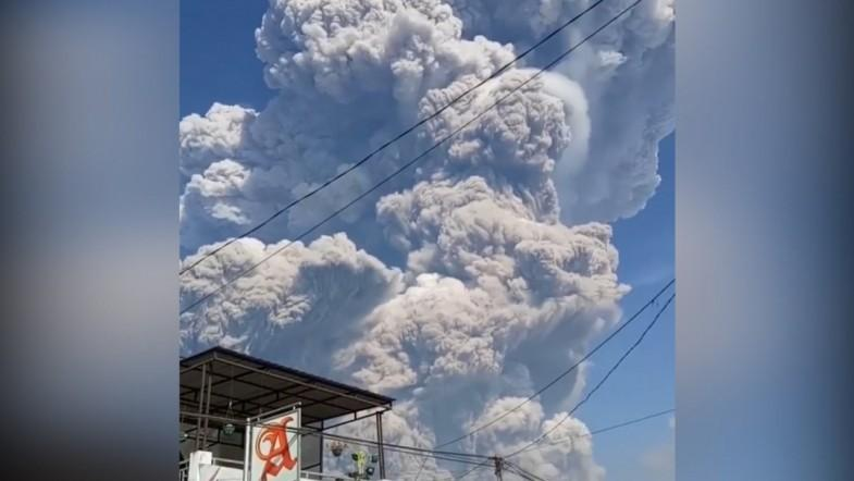 Mount Sinabung erupts and spews massive columns of ash into sky