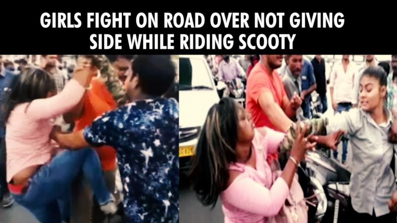 Girls fight on road over not giving side while riding scooty