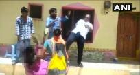 TRS member kicks woman