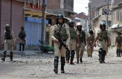 Indian security forces during curfew in Srinagar