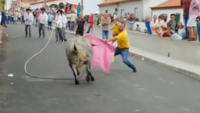 Shocking Video Shows Man Fighting Bull While Holding Small Child