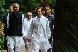 President of the Indian National Congress Party Rahul Gandhi (R) talks with Congress party's national general secretary Ashok Gehlot (L)