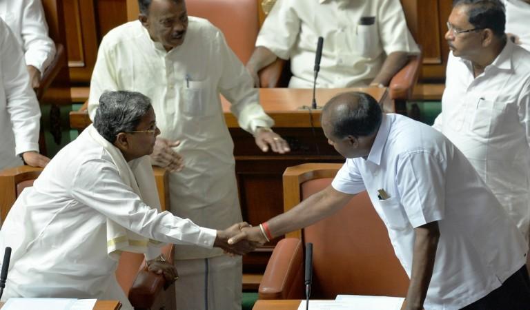 H.D Kumaraswamy (R) greets former Chief Minister Siddaramaiah