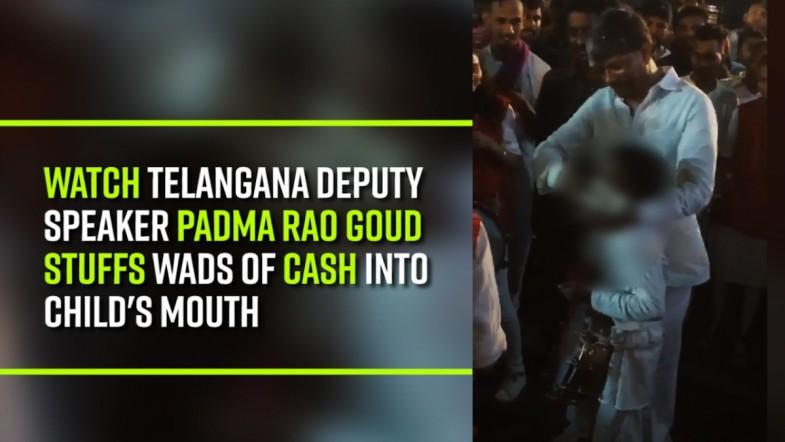 Telangana deputy speaker stuffs wads of cash into childs mouth