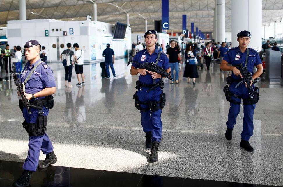 Hong Kong airport resumes operations as China calls protests 'near-terrorist acts'