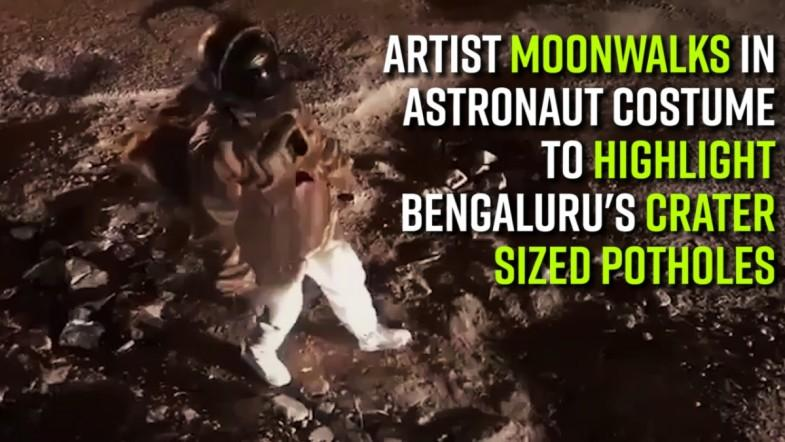 Artist moonwalks on road in astronaut costume to highlight Bengalurus crater-sized potholes