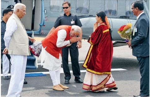 Fact Check: PM Modi shows respect by bowing but not before industrialist Adani's wife