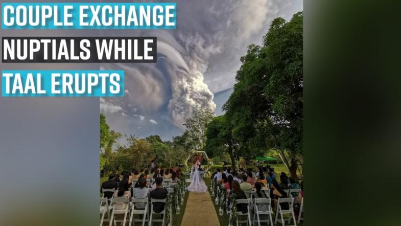 Couple exchange nuptials while Taal erupts