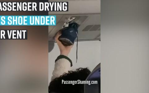Passenger drying his shoes under air vent