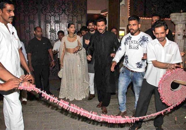 Sonam Kapoor bursting crackers with her father Anil Kapoor during Diwali