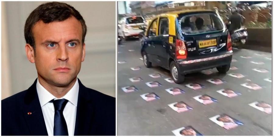 Posters of Emmanuel Macron stuck on Bhendi Bazaar road.