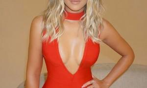 Hollywood actress Khloé Kardashian flashes her cleavage.