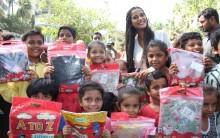 Bollywood actress Poonam Pandey distribute raincoats to street children in Mumbai.