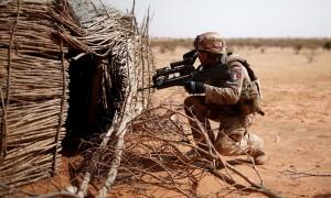A French soldier of the 13th engineering regiment controls a touareg home near Tin Hama, Mali.