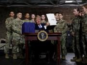 President Donald Trump signs $716 billion defence policy bill