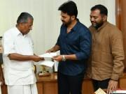 Kerala flood relief: Suriya, Karthi donate Rs 10 lakh; give cheque to Mohanlal