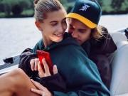 Hailey Baldwin flaunts engagement ring as she cuddles up with fiance Justin Bieber
