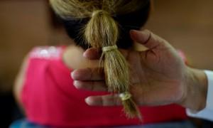 Stylist Sandra Hernandez shows condoms used as as hairbands